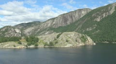 Norway passing a barren island in Lysefjord s Stock Footage