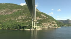Norway moving under a bridge across Lysefjord s Stock Footage