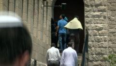 Arabs on the Way to Friday Prayer in Jerusalem 2 Stock Footage