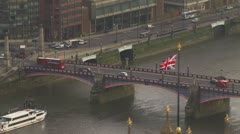 Aerial view over Lambeth bridge which crosses the River Thames in London Stock Footage
