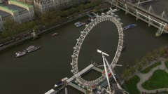 Aerial view of the London eye and the River Thames - stock footage