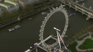 Aerial view of the London eye and the River Thames Stock Footage