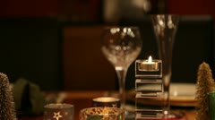 Christmas table CU RL pan candle and glasses RT v1 Stock Footage