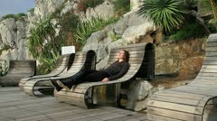 Girl Relaxing in a Beautiful Garden - stock footage