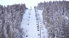 Ski chair lift in winter setting Stock Footage