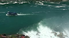 Boat tour of Niagara Falls inside the curve Horseshoe Falls. Stock Footage