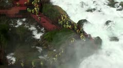 Tourist crowd in Cave of the Winds at Niagara Falls (behind Bridal Veil falls) Stock Footage