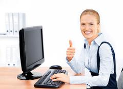Businesswoman with thumbs up. Stock Photos