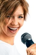 girl singing on white background - stock photo