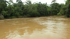 Traveling down Rio Cononaco in a motorised canoe in the Ecuadorian Amazon Stock Footage