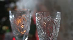 Champagne into wine glasses Stock Footage