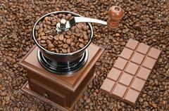 Old coffee grinder and chocolate Stock Photos