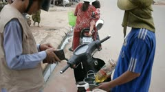 Fill up gas to a motorbike in Siem Reap, Cambodia - stock footage