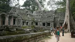Foreign visitors touring Angkor Wat temple Ta Prohm in Cambodia Stock Footage