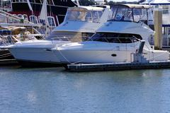 Two boats dock in a marina - stock photo