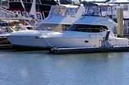 Two boats dock in a marina Stock Photos