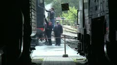Vintage Locomotive Cleaners Working on Engine Stock Footage