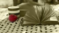 Wind turn old Book Pages on the table in sepia colors Stock Footage