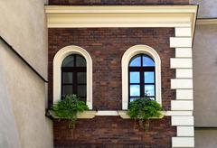facade of an old house with arc windows - stock photo