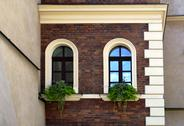 Stock Photo of facade of an old house with arc windows