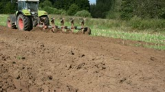 Heavy agricultural machine work in field Stock Footage