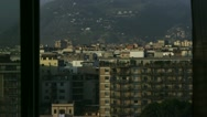 Stock Video Footage of Urban scape of Palermo through the window zoom out