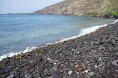 surf and eroded lava rocks .. - stock photo