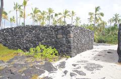 Ancient hawaiian volcanic stone wall .. Stock Photos
