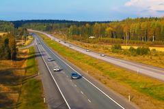 Autobahn traffic - stock photo