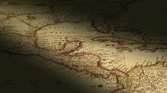 Pan across antique map with narrow beam of light across the surface. - stock footage