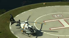 Helicopter on hospital launch pad Stock Footage