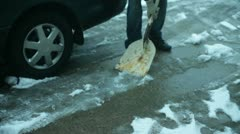 Shoveling snow ice road Stock Footage