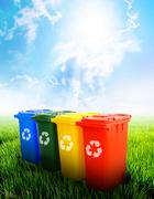 colorful recycle bins with landscape background - stock photo