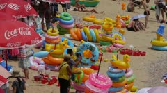 A lot of people at crowded bathing sandy beach.Many swimming circle,QingDao. Stock Footage
