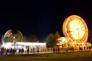 Traveling carnival at night motion blur Stock Photos