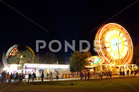 Stock photo of Traveling carnival at night motion blur