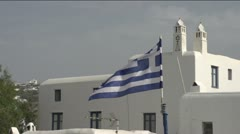 flag above Greek village birds and blues and whites - stock footage