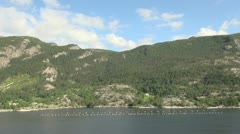 Norway A fish farm in Lysefjord with mountains above s Stock Footage