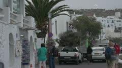 street life in Greek village, men working, tourists walking - stock footage