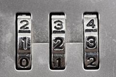 Macro of combination lock - dials set to 123,  shallow dof Stock Photos