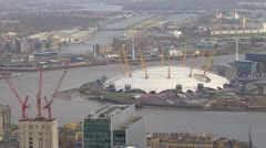 Aerial shot over the River Thames and the O2 Arena - stock footage