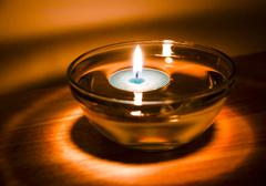 Aromatherapy candle floating in oil Stock Photos