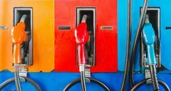 Colorful fuel oil gasoline dispenser at petrol filling station Stock Photos