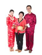 chinese new year family with ang pow symbol of luck - stock photo