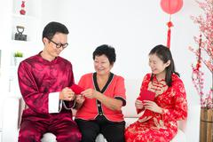 chinese new year family with good luck wishes - stock photo