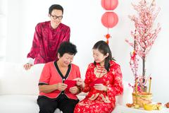 chinese new year family with ang pow - stock photo