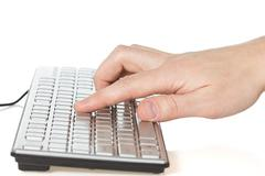 Hand typing on  computer keyboard Stock Photos