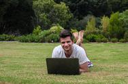 Man working on notebook outdoors Stock Photos