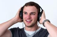 Stock Photo of close up of face of young man listening to music