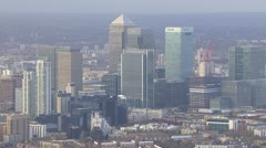 Aerial view of the distinctive towers of Canary Wharf in London Stock Footage